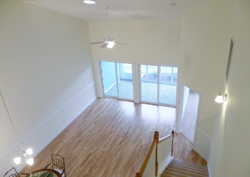 sloped ceilings and double doors make this room feel even bigger
